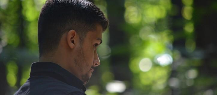 refugee man in forest