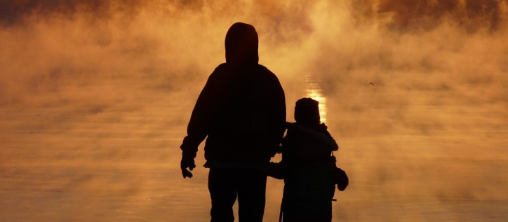 Family children looking at sunset