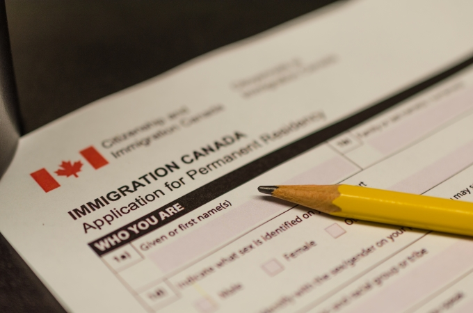 Canadian Immigration lawyer assisting client with Permanent Residency Card Renewal