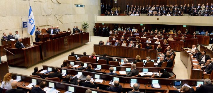 Politicians in Israel's legislative assembly discuss and debate, but the Israeli Prime Minister Benjamin Netanyahu has frozen a proposed plan to resettle thousands of African migrants living in Israel.