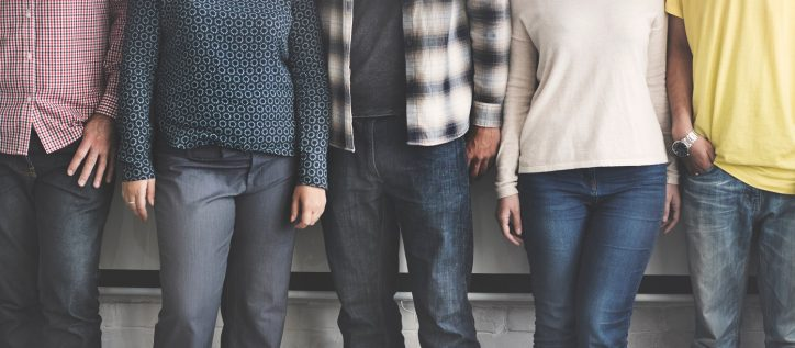 Diverse individuals stand together