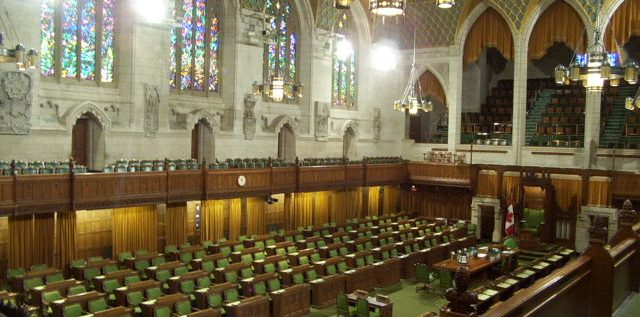 The interior of the House of Commons of Canada, Centre Block on Parliament Hill.