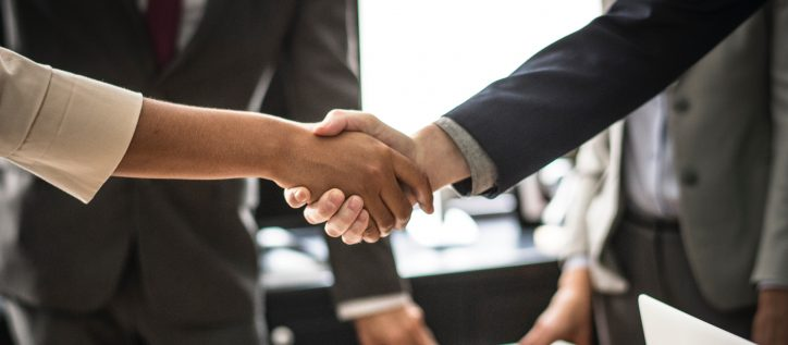 Immigration lawyers shaking hands with client