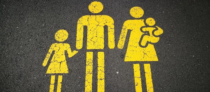 Family figures painted in yellow on pavement
