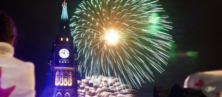 Fireworks burst in the sky behind Canada's Peace Tower.