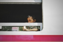 Young child sits on a bus