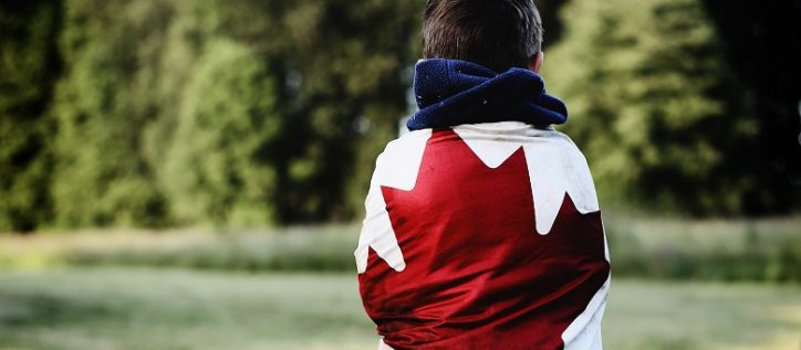 Person wrapped in Canadian flag