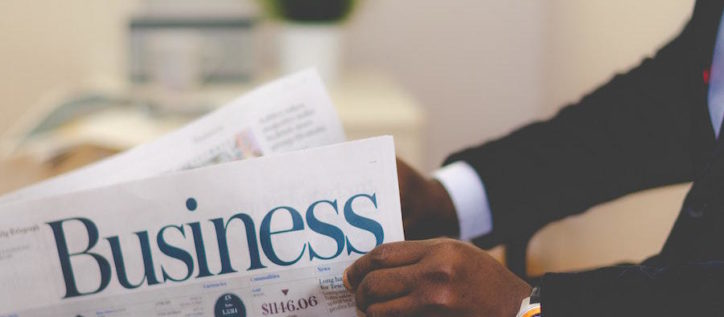 Person reading business newspaper