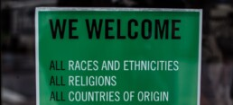 Sign that says We welcome all races, ethnicities, religion, and country of origin
