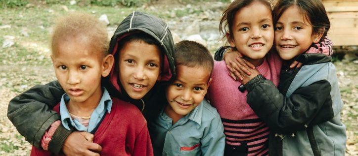 Refugee children embracing each other