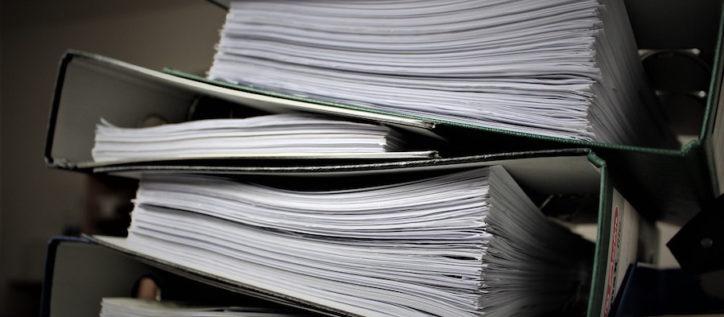 Stacks of documents in binders