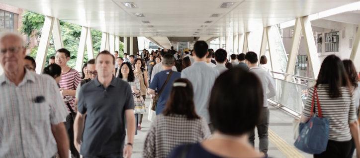People walking through a hallway