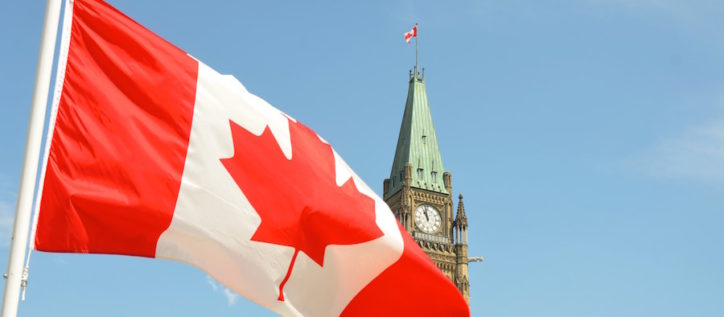 Canada flag in front of parliament