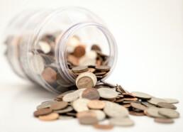 Jar of coins spilling over