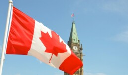 Canada flag hanging in front of the Peace Tower